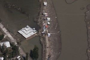 Flood victims set up temporary shelters along a street next to a mosque on the outskirts of Srinagar