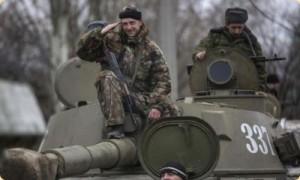 -ДНР-готовятся-к-отводу-тяжелого-вооружения-из-Донецкого-региона-28.02.2015-REUTERS-Baz-Ratner-672x372