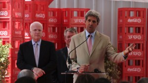 U.S. Senators John McCain (L) and John Kerry (R) talk during a news conference at a Coca Cola factory during their visit to Cairo, June 26, 2011. REUTERS/Asmaa Waguih/ (EGYPT - Tags: POLITICS FOOD)