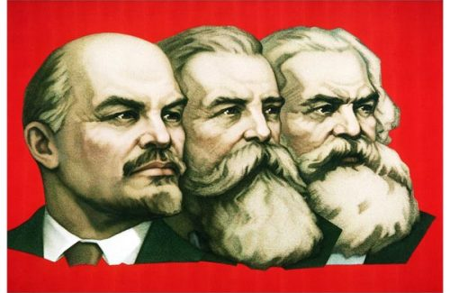 A closeup of a banner depicting Lenin, Karl Marx, and Friedrich Engels in Moscow's Red Square in preparation for May Day celebrations.  The square is prepared for festivities to commemorate the 40th anniversary of the Russian defeat of the German Nazis at the end of WWII.