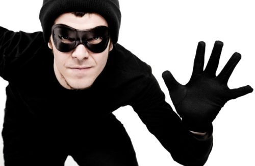 Thief reaching his hand. Low saturation. Clipping path included.