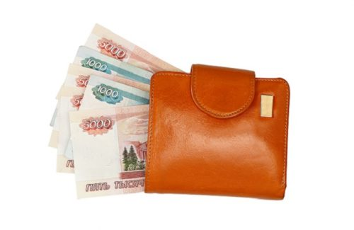 Leather wallet with money isolated on white background. Wallet with ruble bills. With clipping path.