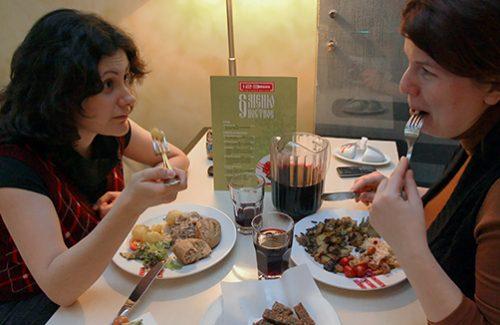 "MOSCOW, RUSSIA. 2010. Two women eating Lenten dishes at a 1-2-3 cafe. (Photo ITAR-TASS/ Alexandra Mudrats)  Россия. Москва. Посетители во время обеда в ""1-2-3 кафе"". Фото ИТАР-ТАСС/ Александра Мудрац"